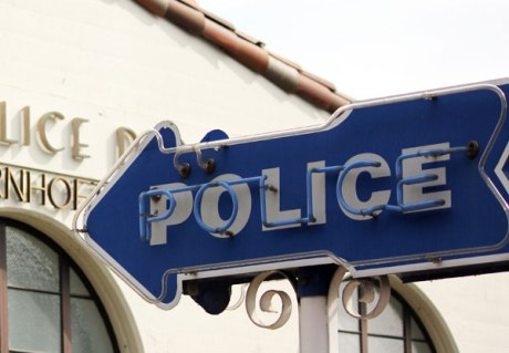 Police-sign-with-building-crop-small