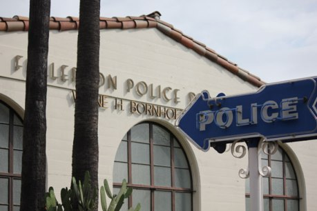 Police-sign-with-building-small