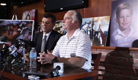 Ron Thomas and his lawyer, Garo Miradrossian. Image stolen from the OC Register.